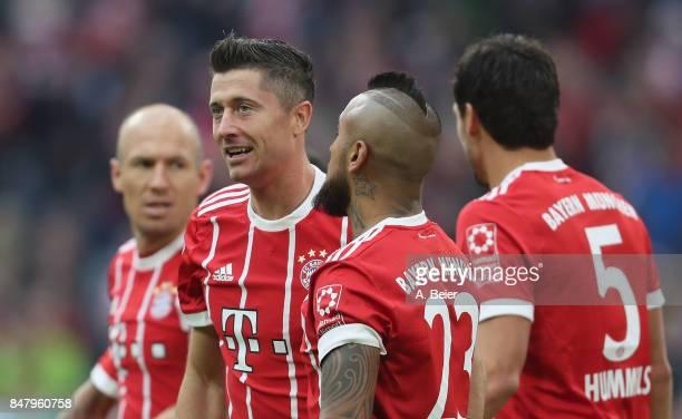 Robert Lewandowski of FC Bayern Muenchen celebrates his first goal with teammates Arjen Robben Arturo Vidal and Mats Hummels during the Bundesliga...