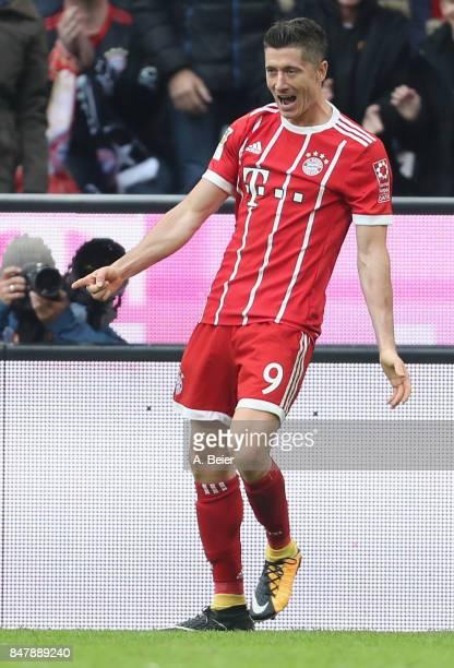 Robert Lewandowski of FC Bayern Muenchen celebrates his second goal during the Bundesliga match between FC Bayern Muenchen and 1 FSV Mainz 05 at...
