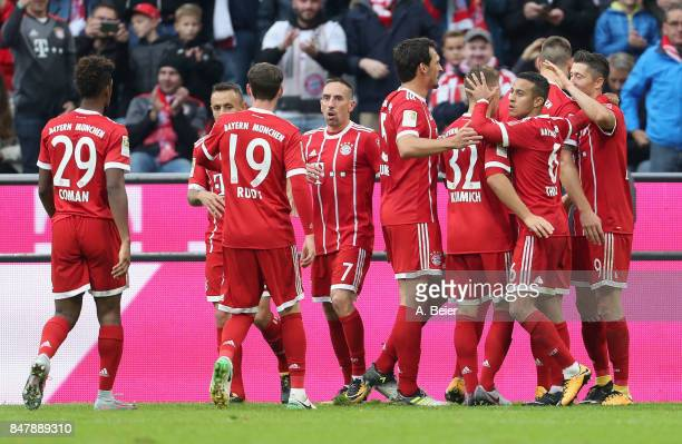 Robert Lewandowski of FC Bayern Muenchen celebrates his second goal with teammates during the Bundesliga match between FC Bayern Muenchen and 1 FSV...