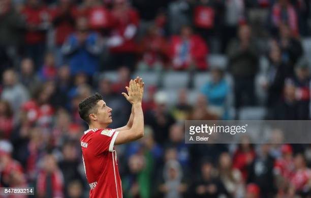 Robert Lewandowski of FC Bayern Muenchen celebrates his team's victory after the Bundesliga match between FC Bayern Muenchen and 1 FSV Mainz 05 at...