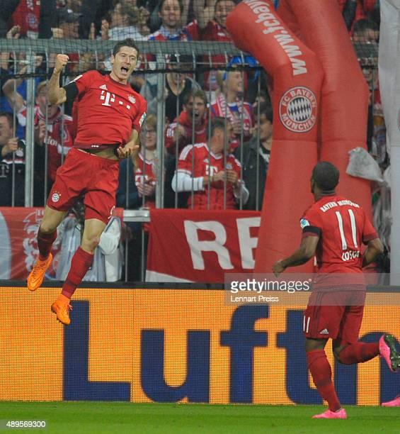 Robert Lewandowski of FC Bayern Muenchen celebrates his third goal during the Bundesliga match between FC Bayern Muenchen and VfL Wolfsburg at...