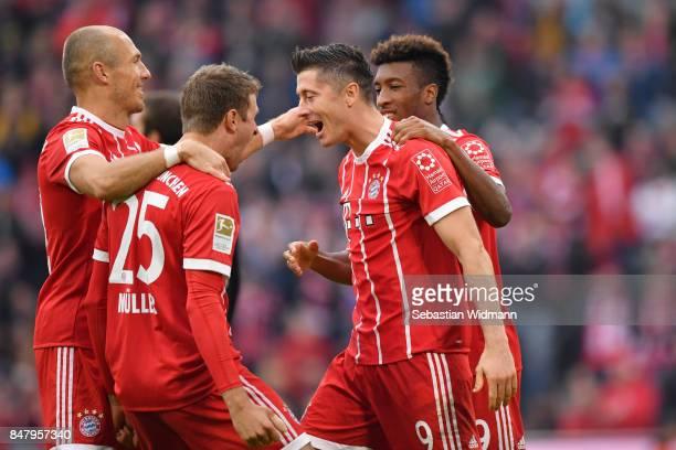 Robert Lewandowski of FC Bayern Muenchen celebrates scoring his teams third goal with Arjen Robben Thomas Mueller and Kingsley Coman during the...