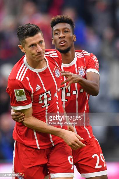 Robert Lewandowski of FC Bayern Muenchen celebrates scoring his teams third goal with Kingsley Coman during the Bundesliga match between FC Bayern...