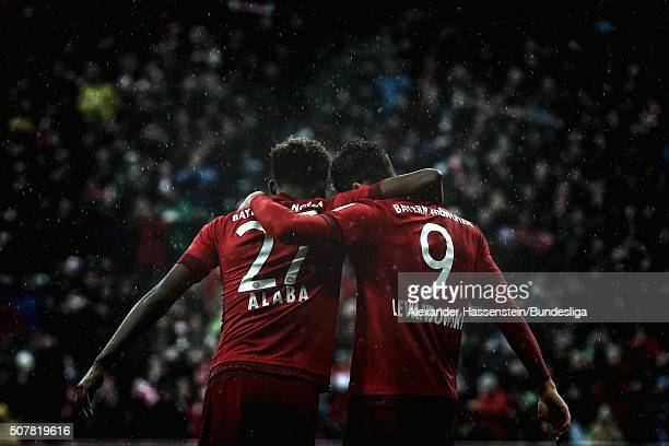 Robert Lewandowski of FC Bayern Muenchen celebrates scoring the 2nd team goal with his team mate David Alaba during the Bundesliga match between FC...