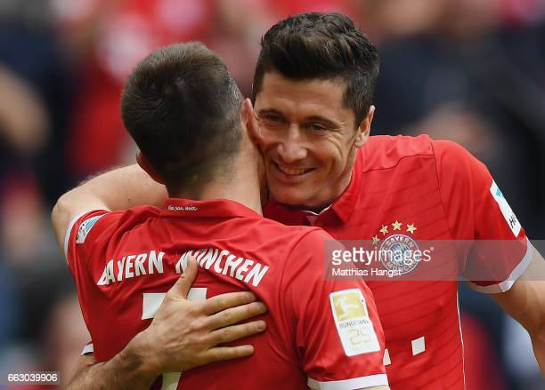 Robert Lewandowksi of FC Bayern Muenchen celebrates with his teammate Franck Ribery of FC Bayern Muenchen after scoring his team's third goal during...