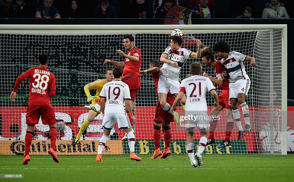 <a gi-track='captionPersonalityLinkClicked' href=/galleries/search?phrase=Robert+Lewandowski&family=editorial&specificpeople=5532633 ng-click='$event.stopPropagation()'>Robert Lewandowski</a> of FC Bayern Muenchen heads the ball against <a gi-track='captionPersonalityLinkClicked' href=/galleries/search?phrase=Oemer+Toprak&family=editorial&specificpeople=5395932 ng-click='$event.stopPropagation()'>Oemer Toprak</a> of Bayer Leverkusen during the DFB Cup Quarter Final match between Bayer Leverkusen and FC Bayern Muenchen at BayArena on April 8, 2015 in Bielefeld, Germany.