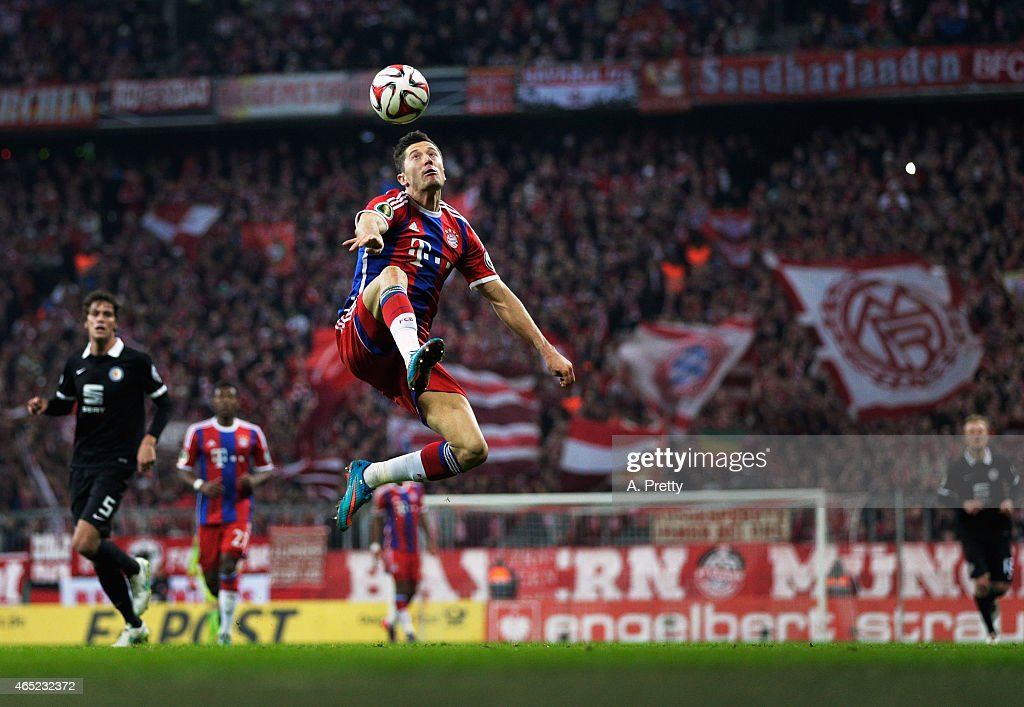 Robert Lewandowski of FC Bayern Muenchen in action during the DFB Cup match between FC Bayern Muenchen and Eintracht Braunschweig at Allianz Arena on...