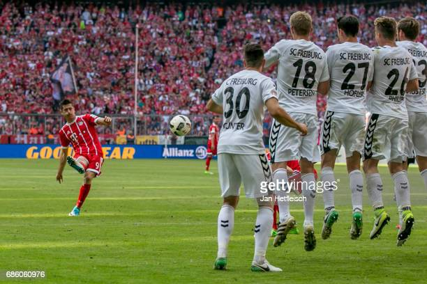 Robert Lewandowski of FC Bayern Muenchen in action during the Bundesliga match between Bayern Muenchen and SC Freiburg at Allianz Arena on May 20...