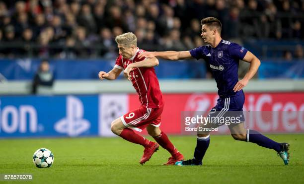 Robert Lewandowski of FC Bayern Muenchen is challenged by Leander Dendoncker of Anderlecht during the UEFA Champions League group B match between RSC...