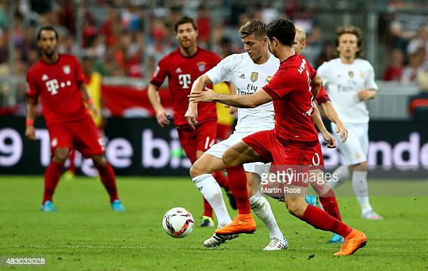 Robert Lewandowski of FC Bayern Muenchen is challenged by Toni Kroos of Real Madird during the Audi Cup 2015 final match between FC Bayern Muenchen...