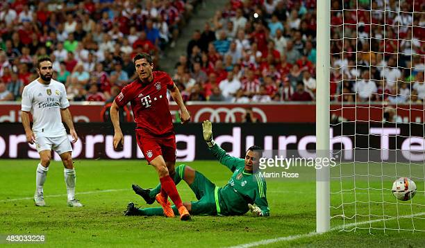 Robert Lewandowski of FC Bayern Muenchen is scoring the winning goal during the Audi Cup 2015 final match between FC Bayern Muenchen and Real Madrid...