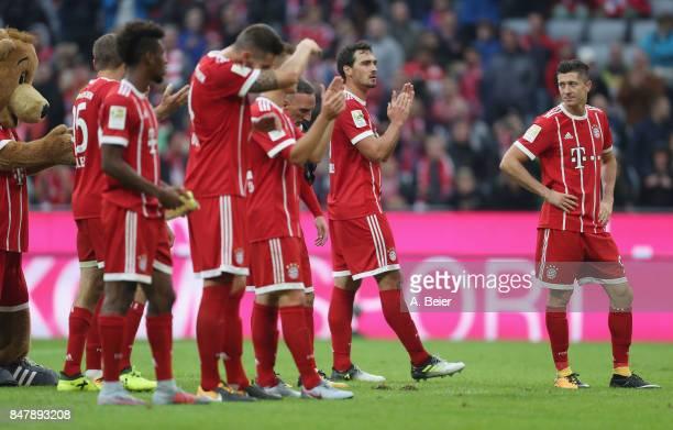 Robert Lewandowski of FC Bayern Muenchen looks at his teammates after the Bundesliga match between FC Bayern Muenchen and 1 FSV Mainz 05 at Allianz...