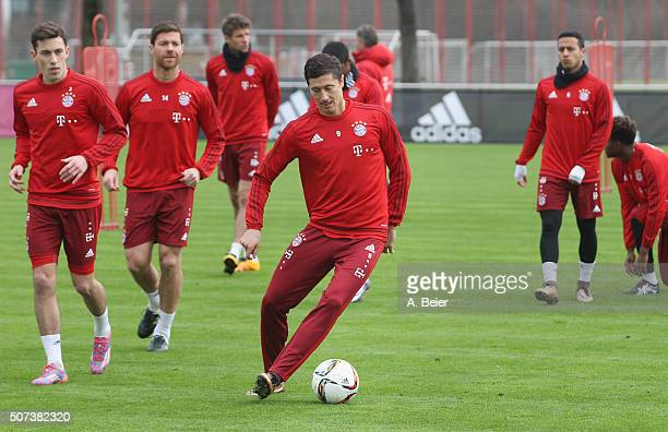 Robert Lewandowski of FC Bayern Muenchen plays the ball during a training session at the Saebener Strasse training ground on January 29 2016 in...