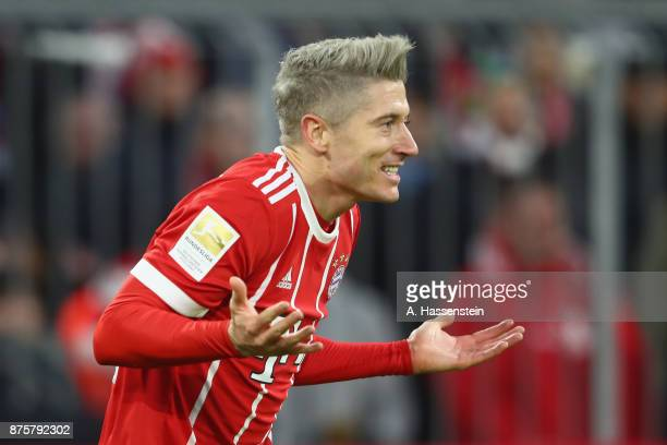 Robert Lewandowski of FC Bayern Muenchen reacts during the Bundesliga match between FC Bayern Muenchen and FC Augsburg at Allianz Arena on November...