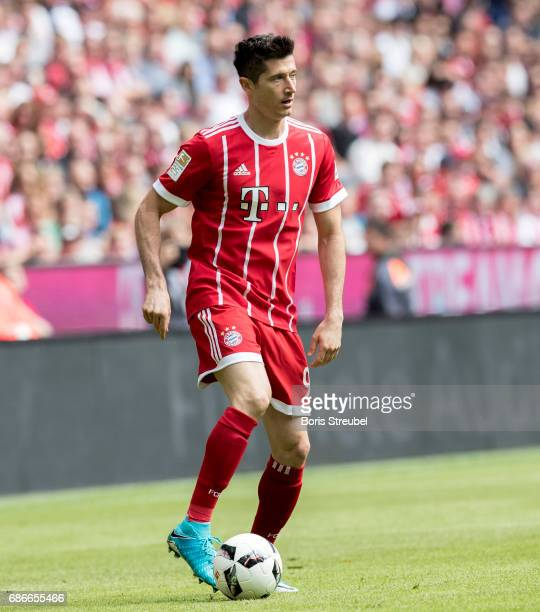 Robert Lewandowski of FC Bayern Muenchen runs with the ball during the Bundesliga match between Bayern Muenchen and SC Freiburg at Allianz Arena on...