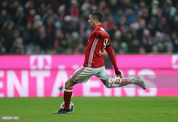 Robert Lewandowski of FC Bayern Muenchen scores a penalty goal against RB Leipzig during the Bundesliga match between Bayern Muenchen and RB Leipzig...