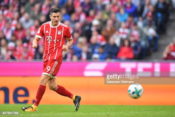 Robert Lewandowski of FC Bayern Muenchen scoring his teams fourth goal during the Bundesliga match between FC Bayern Muenchen and 1 FSV Mainz 05 at...