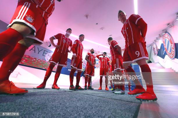 Robert Lewandowski of FC Bayern Muenchen wait with his team mates at the players tunnel to enter the field of play for the Bundesliga match between...