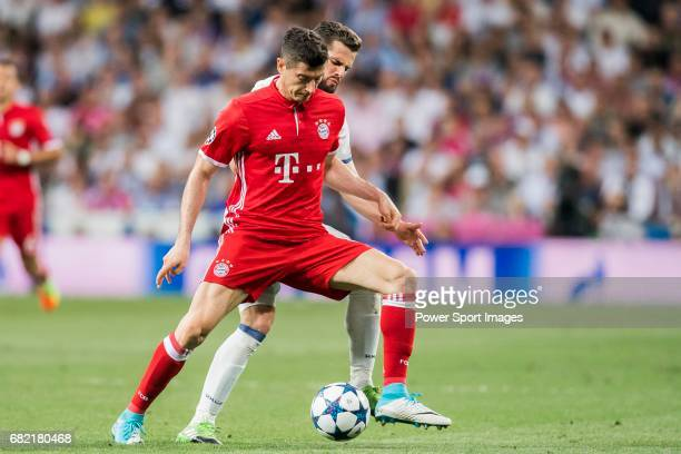 Robert Lewandowski of FC Bayern Munich battles for the ball with Nacho Fernandez of Real Madrid during their 201617 UEFA Champions League...