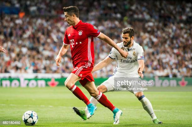Robert Lewandowski of FC Bayern Munich fights for the ball with Nacho Fernandez of Real Madrid during their 201617 UEFA Champions League...