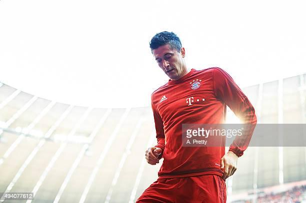Robert Lewandowski of FC Bayern Munich leaves the field after warm up before the Bundesliga match between FC Bayern Muenchen and 1 FC Koeln at...