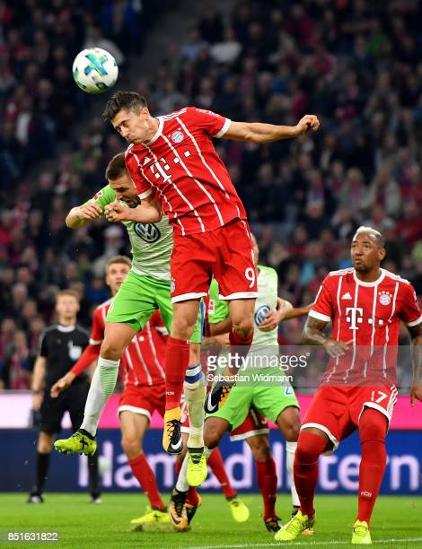 Robert Lewandowski of Muenchen and Ignacio Camacho of Wolfsburg head for the ball during the Bundesliga match between FC Bayern Muenchen and VfL...