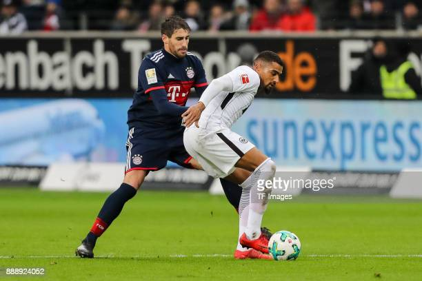 Robert Lewandowski of Muenchen and KevinPrince Boateng of Frankfurt battle for the ball during the Bundesliga match between Eintracht Frankfurt and...