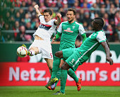Robert Lewandowski of Muenchen battles for the ball with Assani Lukimya of Bremen and his team mate Philipp Bargfrede during the Bundesliga match...