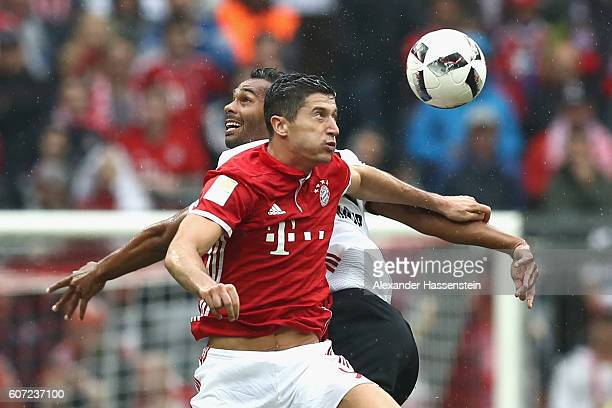 Robert Lewandowski of Muenchen battles for the ball with Marvin Matip of Ingolstadt during the Bundesliga match between Bayern Muenchen and FC...