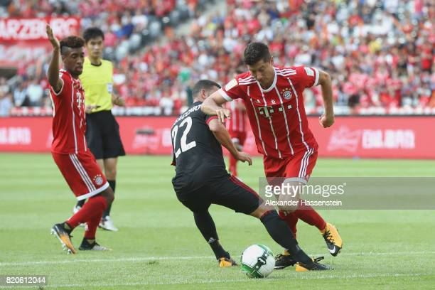 Robert Lewandowski of Muenchen battles for the ball with Mateo Musacchio of Milan during the International Champions Cup Shenzen 2017 match between...