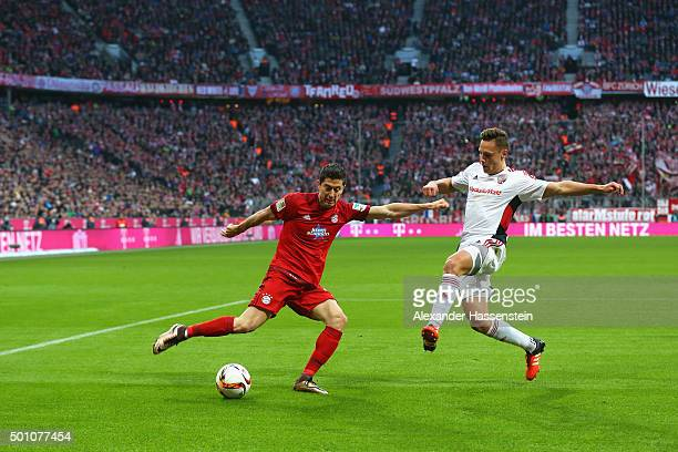 Robert Lewandowski of Muenchen battles for the ball with Robert Bauer of Ingolstadt during the Bundesliga match between FC Bayern Muenchen and FC...