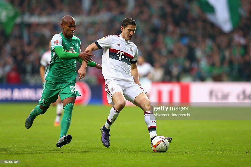 Robert Lewandowski of Muenchen battles for the ball with Theodor Gebre Selassie of Bremen during the Bundesliga match between SV Werder Bremen and FC...