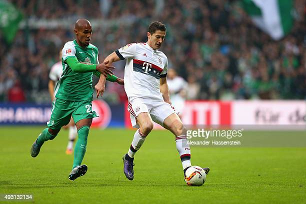 Robert Lewandowski of Muenchen battles for the ball with Theodor Gebre Selassie of Bremen during the Bundesliga match between SV Werder Bremen and FC...