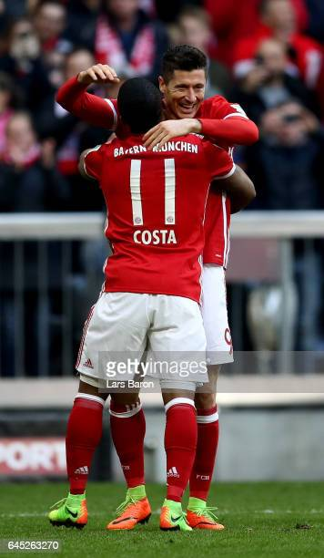 Robert Lewandowski of Muenchen celebrate with team mate Douglas Costa after he scores the 3rd goal during the Bundesliga match between Bayern...