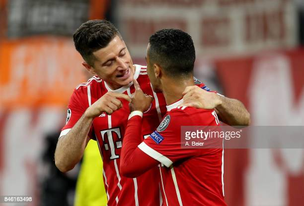 Robert Lewandowski of Muenchen celebrate with team mate Thiago the 2nd goal during the UEFA Champions League group B match between Bayern Muenchen...
