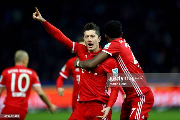 Robert Lewandowski of Muenchen celebrates after he scores the equalizing goal during the Bundesliga match between Hertha BSC and Bayern Muenchen at...