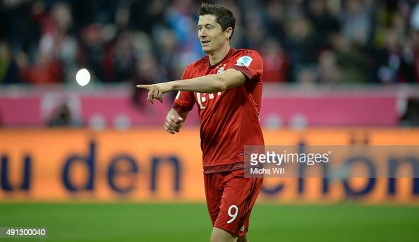 Robert Lewandowski of Muenchen celebrates after scoring his team's fourth goal during the Bundesliga match between FC Bayern Muenchen and Borussia...
