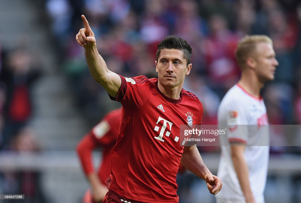 <a gi-track='captionPersonalityLinkClicked' href=/galleries/search?phrase=Robert+Lewandowski&family=editorial&specificpeople=5532633 ng-click='$event.stopPropagation()'>Robert Lewandowski</a> of Muenchen celebrates after scoring his team's third goal during the Bundesliga match between FC Bayern Muenchen and 1. FC Koeln at Allianz Arena on October 24, 2015 in Munich, Germany.