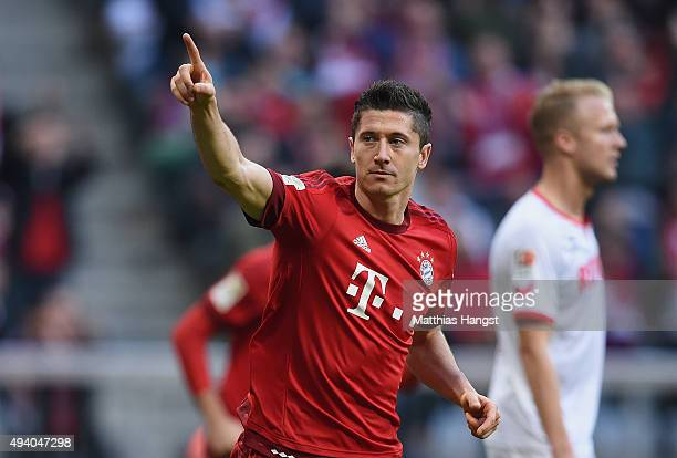 Robert Lewandowski of Muenchen celebrates after scoring his team's third goal during the Bundesliga match between FC Bayern Muenchen and 1 FC Koeln...