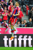 Robert Lewandowski of Muenchen celebrates his opening goal during the Bundesliga match between FC Bayern Muenchen and Hannover 96 at Allianz Arena on...