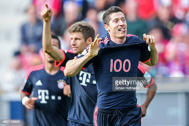Robert Lewandowski of Muenchen celebrates his team's first goal with team mate Thomas Mueller during the Bundesliga match between 1 FSV Mainz 05 and...