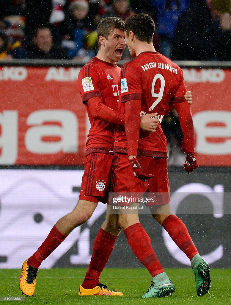 <a gi-track='captionPersonalityLinkClicked' href=/galleries/search?phrase=Robert+Lewandowski&family=editorial&specificpeople=5532633 ng-click='$event.stopPropagation()'>Robert Lewandowski</a> of Muenchen (R) celebrates his team's first goal with team mate <a gi-track='captionPersonalityLinkClicked' href=/galleries/search?phrase=Thomas+Mueller&family=editorial&specificpeople=5842906 ng-click='$event.stopPropagation()'>Thomas Mueller</a> during the Bundesliga match between FC Ausgburg and FC Bayern Muenchen at SGL Arena on February 14, 2016 in Augsburg, Germany.