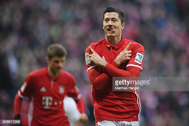 Robert Lewandowski of Muenchen celebrates his team's second goal during the Bundesliga match between Bayern Muenchen and VfL Wolfsburg at Allianz...