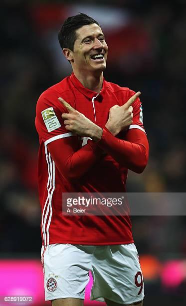 Robert Lewandowski of Muenchen celebrates scoring his second goal during the Bundesliga match between Bayern Muenchen and VfL Wolfsburg at Allianz...
