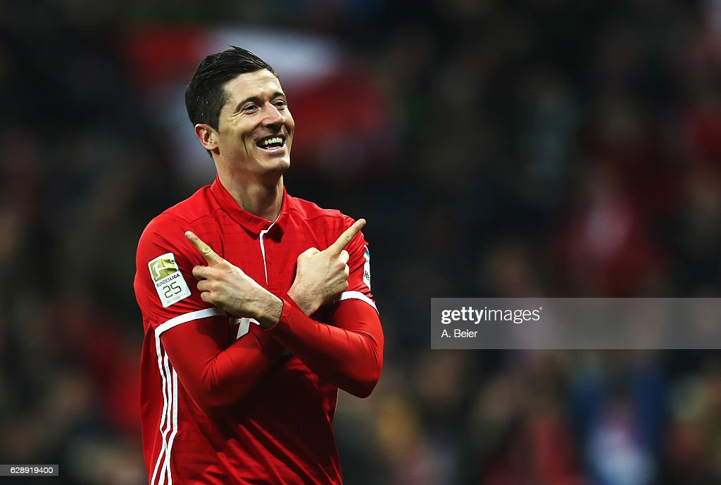 Robert Lewandowski of Muenchen celebrates scoring his second goal during the Bundesliga match between Bayern Muenchen and VfL Wolfsburg at Allianz Arena on December 10, 2016 in Munich, Germany.