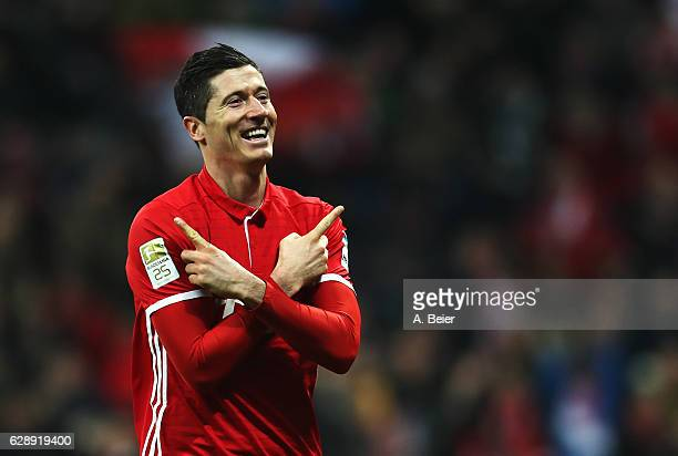 Robert Lewandowski of Muenchen celebrates scoring his second goal during the Bundesliga match between Bayern Muenchen and VfL Wolfsburg at Allianz...