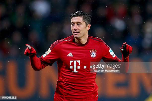 Robert Lewandowski of Muenchen celebrates scoring the 2nd team goal during the Bundesliga match between FC Augsburg and FC Bayern Muenchen at WWK...