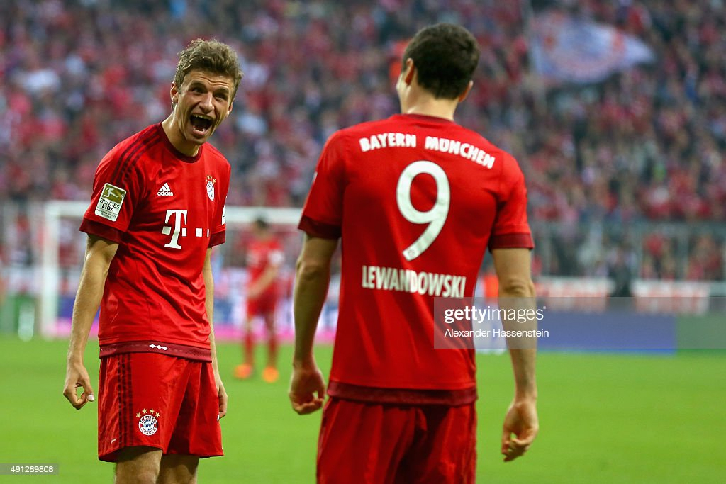 <a gi-track='captionPersonalityLinkClicked' href=/galleries/search?phrase=Robert+Lewandowski&family=editorial&specificpeople=5532633 ng-click='$event.stopPropagation()'>Robert Lewandowski</a> of Muenchen celebrates scoring the 3rd team goal with his team mate Thomas Mueller during the Bundesliga match between FC Bayern Muenchen and BVB Borussia Dortmund at Allianz Arena on October 4, 2015 in Munich, Germany.