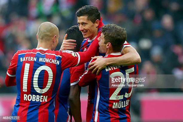 Robert Lewandowski of Muenchen celebrates scoring the 6th goal with his team mates Thomas Mueller Juan Bernat and Arjen Robben during the Bundesliga...