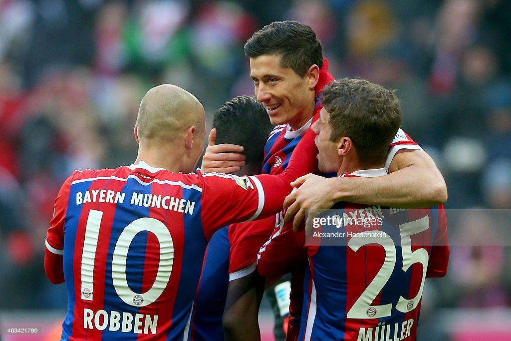 <a gi-track='captionPersonalityLinkClicked' href=/galleries/search?phrase=Robert+Lewandowski&family=editorial&specificpeople=5532633 ng-click='$event.stopPropagation()'>Robert Lewandowski</a> (C) of Muenchen celebrates scoring the 6th goal with his team mates <a gi-track='captionPersonalityLinkClicked' href=/galleries/search?phrase=Thomas+Mueller&family=editorial&specificpeople=5842906 ng-click='$event.stopPropagation()'>Thomas Mueller</a> (R), <a gi-track='captionPersonalityLinkClicked' href=/galleries/search?phrase=Juan+Bernat&family=editorial&specificpeople=8821838 ng-click='$event.stopPropagation()'>Juan Bernat</a> and <a gi-track='captionPersonalityLinkClicked' href=/galleries/search?phrase=Arjen+Robben&family=editorial&specificpeople=194740 ng-click='$event.stopPropagation()'>Arjen Robben</a> (L) during the Bundesliga match between FC Bayern Muenchen and Hamburger SV at Allianz Arena on February 14, 2015 in Munich, Germany.